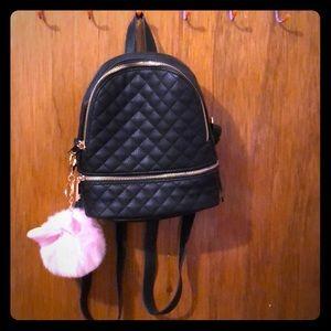 Handbags - Mini faux letter backpack